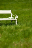 Summer - White bench in green meadow Stock Image