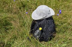 Summer white hat on a backpack in the meadow with purple bell or campanula patula flower, Vitosha mountain. Bulgaria royalty free stock photo