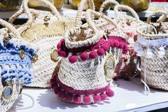 Summer wicker bags made of straw and rattan on the market royalty free stock images