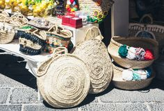 Summer wicker bags made of straw and rattan on the market in Taormina, Sicily, Italy royalty free stock image