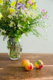 Summer wild flowers with peaches Royalty Free Stock Photo