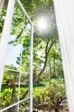 Summer window. Window open to sunny, summer garden Royalty Free Stock Photography