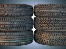 Summer and winter car tires Royalty Free Stock Photos