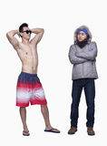 Summer and winter clothes, young men, opposite, studio shot Stock Image