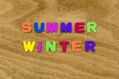 Summer winter seasons hot cold children letters. School learning plastic season learn spell spelling english language preschool words royalty free stock photos