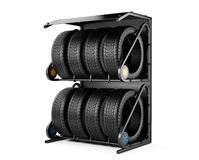 Summer and winter tires set for sale at a tire store. Royalty Free Stock Photos