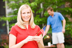 Summer: Woman with American Flag Stock Photo