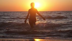 Summer woman beach freedom happy concept. Young woman running into the sea. Free during holidays vacation travel. slow. Summer woman beach freedom happy concept stock footage