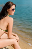 Summer woman in bikini alone on beach Stock Photo
