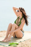 Summer woman in bikini alone on beach Royalty Free Stock Image