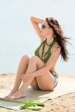 Summer woman in bikini alone on beach Royalty Free Stock Image