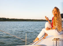 Summer woman on boat taking a picture Stock Images
