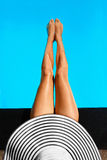Summer Woman Body Care. Long Female Legs In Swimming Pool