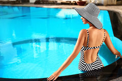 Summer Woman Body Care. Relaxation In Swimming Pool. Holidays Va. Summer Woman Body Care. Beautiful Sexy Girl With Healthy Skin In Elegant Striped Bikini, Sun Royalty Free Stock Images