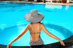 Summer Woman Body Care. Relaxation In Swimming Pool. Holidays Va. Summer Woman Body Care. Beautiful Sexy Girl With Healthy Skin In Elegant Striped Bikini, Sun Royalty Free Stock Image