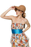 Summer woman in chiffon dress and a hat. Fashion woman wearing light chiffon dress and a hat looking to the side, against white background Royalty Free Stock Photo