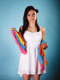 Summer woman with colored shawl on blue Stock Photos