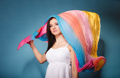 Summer woman with colored shawl on blue Royalty Free Stock Photography