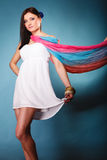 Summer woman with colored shawl on blue Stock Photo
