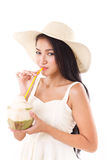 Summer woman drinking coconut juice Stock Images