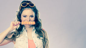 Summer woman eating popsicle ice pop cream Stock Image