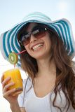 Summer woman with a hat and a drink Royalty Free Stock Photo