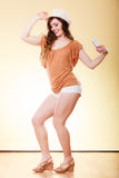 Summer woman holds mobile phone dancing Royalty Free Stock Images
