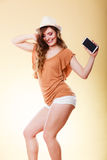 Summer woman holds mobile phone dancing Stock Photos