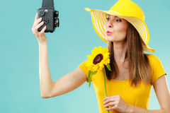 Summer woman holds sunflower old camera Stock Photography