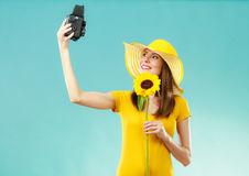 Summer woman holds sunflower old camera Stock Photo