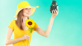 Summer woman holds sunflower old camera Stock Photos