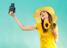 Summer woman holds sunflower old camera Stock Image