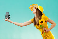 Summer woman holds sunflower old camera Royalty Free Stock Photo