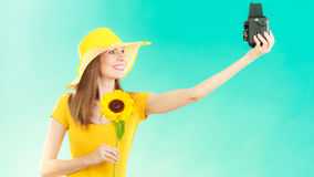Summer woman holds sunflower old camera Royalty Free Stock Images