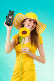 Summer woman holds sunflower old camera Stock Images
