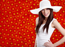Summer woman over red flowers Stock Image