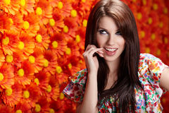 Summer woman over red flowers Royalty Free Stock Photo