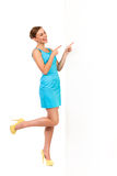 Summer woman pointing at white board and laughing. Royalty Free Stock Images