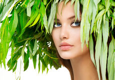 Summer woman portrait. Girl with green leaves on her head. Summer woman portrait royalty free stock photos