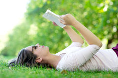 Summer woman reading outdoors Stock Photos