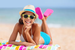 Summer woman relaxing in beach hat and sunglasses. Summer woman relaxing in hipster beach hat and colorful sunglasses. Funky happy girl having fun during travel Royalty Free Stock Image