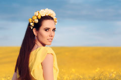 Summer Woman with Roses Wreath in a Field of Flowers Royalty Free Stock Images