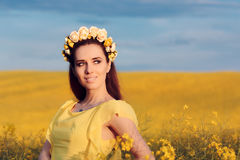 Summer Woman with Roses Wreath in a Field of Flowers Stock Photography