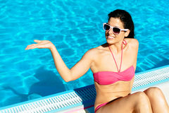 Summer woman showing space with empty hand Stock Photos