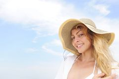 Summer: woman with straw hat  and copy space Royalty Free Stock Images