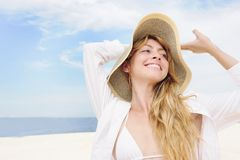 Summer: woman with straw hat  and copy space. Summer: smiling woman with straw hat  and copy space Stock Photography