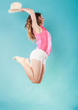 Summer woman in straw hat jumping Stock Photography
