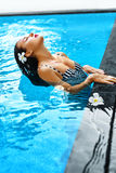 Summer. Woman In Swimming Pool Water. Spa. Body Care, Beauty Stock Images
