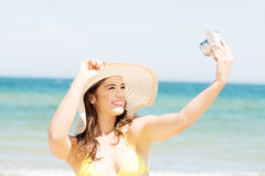 Summer woman talking pictures with digital camera Stock Image