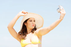 Summer woman talking pictures with digital camera Royalty Free Stock Photo
